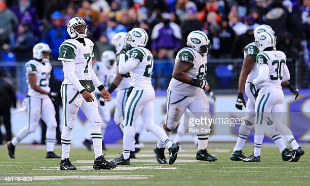 Quarterback Geno Smith of the New York Jets walks off the field after throwing an interception in the fourth quartrer of the Jets 19-3 loss to the...