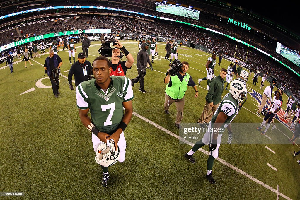 Quarterback Geno Smith #7 of the New York Jets walks off the field after losing 27-19 to the Chicago Bears during a game at MetLife Stadium on September 22, 2014 in East Rutherford, New Jersey.