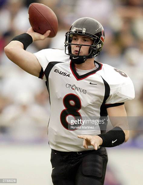 Quarterback Gino Guidugli of the Cincinnati Bearcats throws the ball against the Texas Christian University Horned Frogs at Amon G Carter Stadium on...