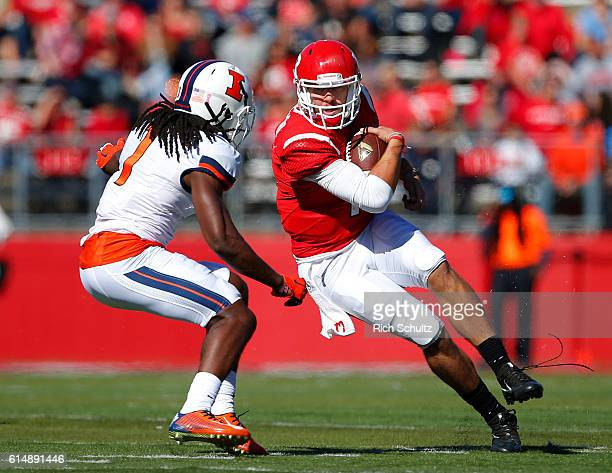 Quarterback Giovanni Rescigno of Rutgers runs for a first down as Jaylen Dunlap of Illinois closes in during the third quarter of a game on October...