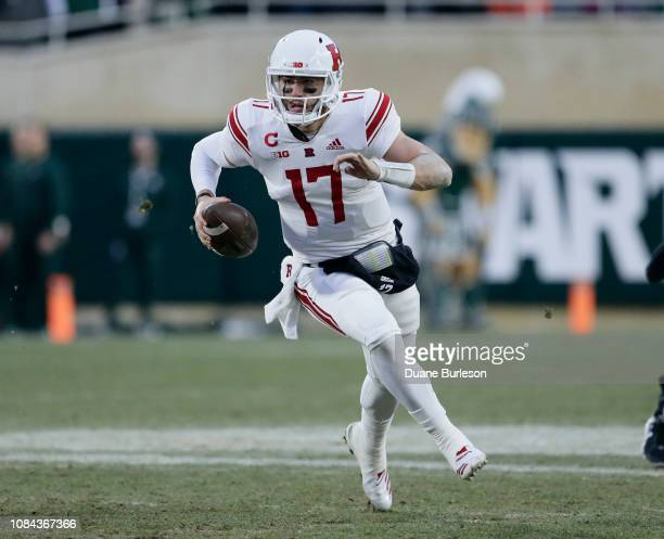 Quarterback Giovanni Rescigno of the Rutgers Scarlet Knights scrambles against the Michigan State Spartans during the first half at Spartan Stadium...
