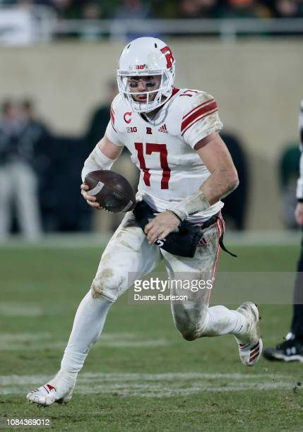 Quarterback Giovanni Rescigno of the Rutgers Scarlet Knights carries the ball against the Michigan State Spartans during the second half at Spartan...