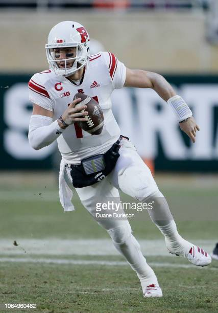 Quarterback Giovanni Rescigno of the Rutgers Scarlet Knights runs against the Michigan State Spartans during the first half at Spartan Stadium on...