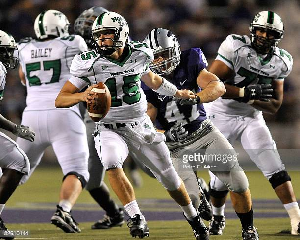 Quarterback Giovanni Vizza of the North Texas Mean Green scrambles away from pressure from linebacker Alex Hrebec of the Kansas State Wildcats in the...