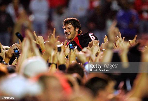 Quarterback Graham Harrell of the Texas Tech Red Raiders celebrates with fans after a 3427 win against the Oklahoma Sooners at Jones ATT Stadium on...