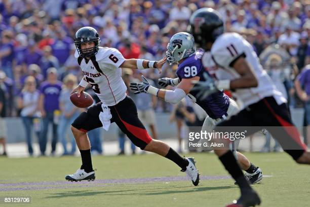 Quarterback Graham Harrell of the Texas Tech Red Raiders scrambles away from pressure from defensive end Ian Campbell of the Kansas State Wildcats in...