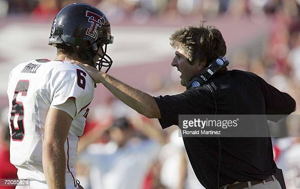 Quarterback Graham Harrell of the Texas Tech Red Raiders talks with head coach Mike Leach during play against the Texas AM Aggies at Kyle Field on...