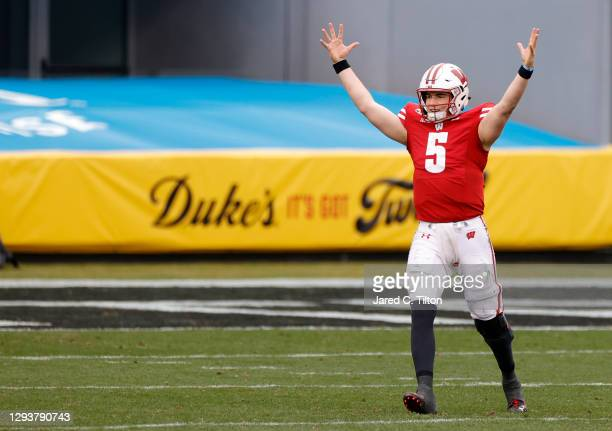 Quarterback Graham Mertz of the Wisconsin Badgers celebrates following a touchdown drive against the Wake Forest Demon Deacons during the fourth...