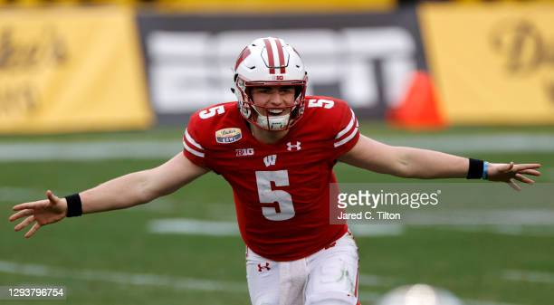 Quarterback Graham Mertz of the Wisconsin Badgers reacts following the final snap and winning the Duke's Mayo Bowl against the Wake Forest Demon...