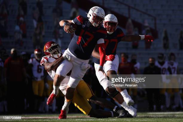 Quarterback Grant Gunnell of the Arizona Wildcats is sacked by linebacker Drake Jackson of the USC Trojans during the second half of the PAC-12...