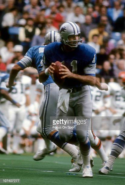 Quarterback Greg Landry of the Detroit Lions drops back to pass against the Cincinnati Bengals during an NFL football game at Riverfront Stadium...