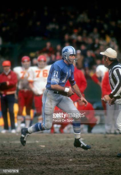 Quarterback Greg Landry of the Detroit Lions runs with the ball against the Kansas City Chiefs during an NFL football game at Tiger Stadium November...