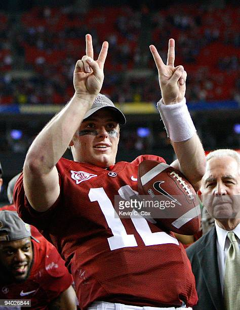 Quarterback Greg McElroy of the Alabama Crimson Tide celebrates after their 3213 win over the Florida Gators in the SEC Championship at Georgia Dome...
