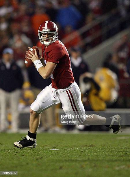 Quarterback Greg McElroy of the Alabama Crimson Tide rolls out to pass against the Auburn Tigers at BryantDenny Stadium on November 29 2008 in...