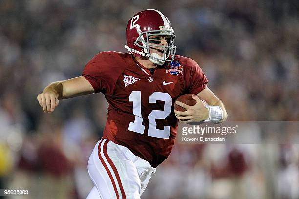 Quarterback Greg McElroy of the Alabama Crimson Tide runs with the ball against the Texas Longhorns in the second quarter of the Citi BCS National...