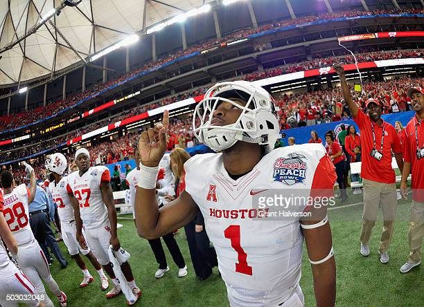 Quarterback Greg Ward Jr. #1 of the Houston Cougars celebrates their 38-24 win over the Florida State Seminoles during the Chick-fil-A Peach Bowl at...