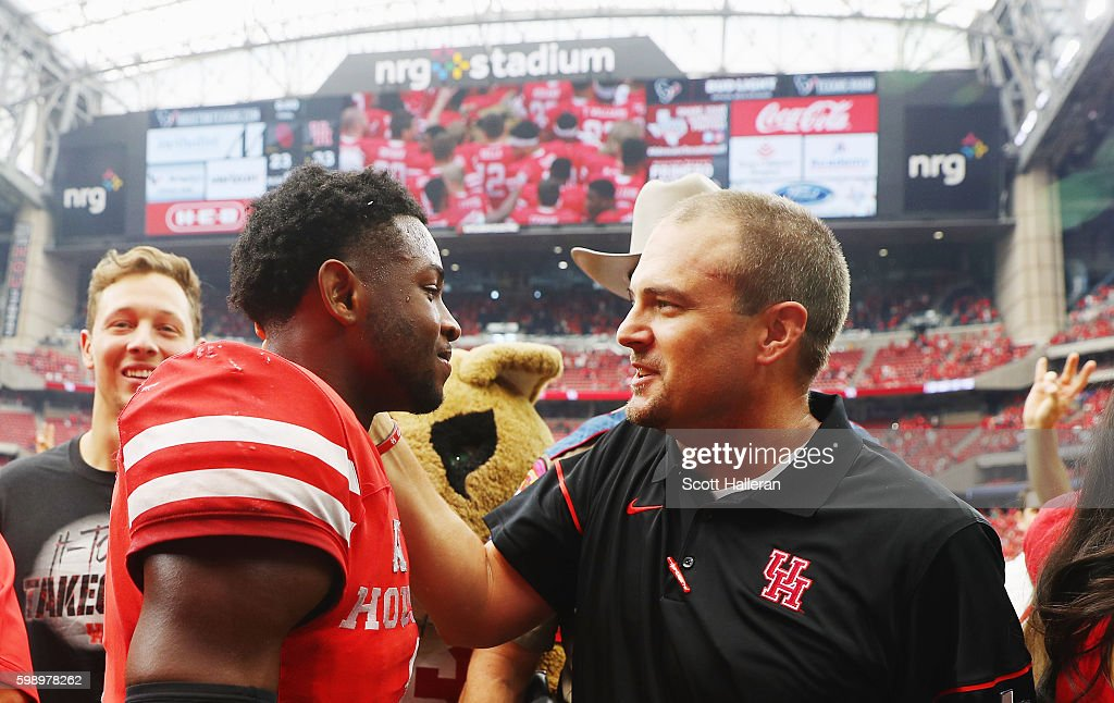 Quarterback Greg Ward Jr. #1 of the Houston Cougars celebrates with his coach Tom Herman after they defeated the Oklahoma Sooners 33-23 during the Advocare Texas Kickoff on September 3, 2016 in Houston, Texas.