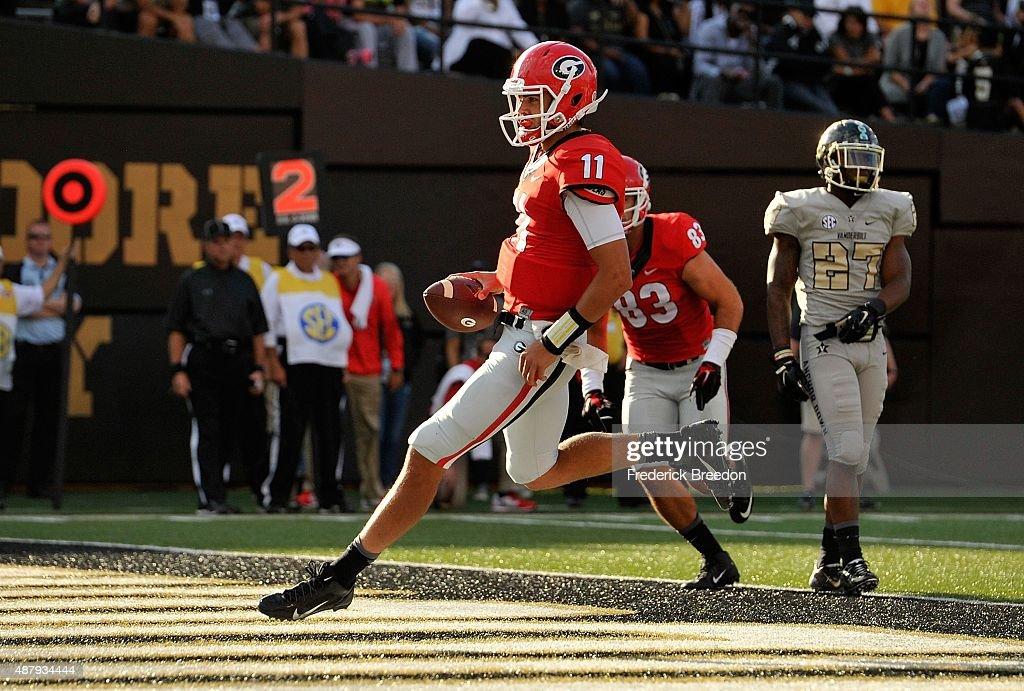 Quarterback Greyson Lambert #11 of the Georgia Bulldogs scores a touchdown against the Vanderbilt Commodores during the second half at Vanderbilt Stadium on September 12, 2015 in Nashville, Tennessee.