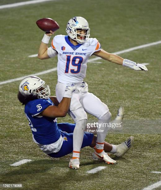 Quarterback Hank Bachmeier of the Boise State Broncos gets rid of the ball as he is brought down by defensive end Viliami Fehoko of the San Jose...