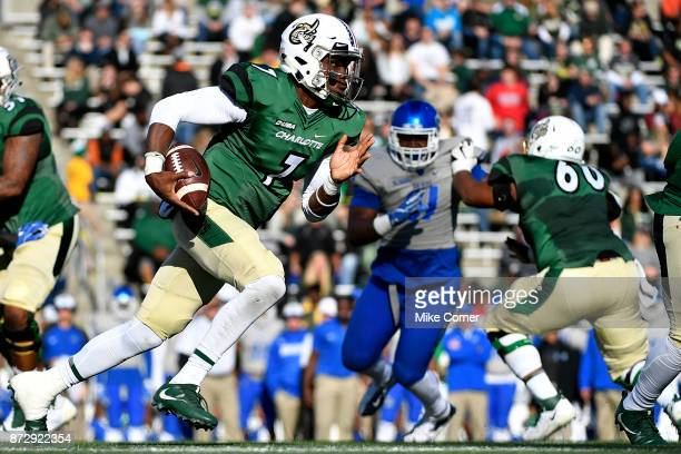 Quarterback Hasaan Klugh of the Charlotte 49ers runs the football agains the Middle Tennessee Blue Raiders during the football game at Jerry...