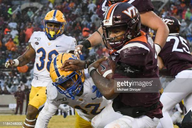 Quarterback Hendon Hooker of the Virginia Tech Hokies is hit by defensive back Paris Ford of the Pittsburgh Panthers in the first half at Lane...
