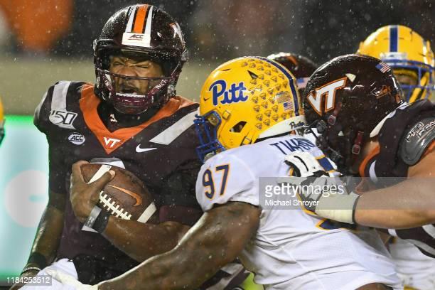 Quarterback Hendon Hooker of the Virginia Tech Hokies is hit by defensive lineman Jaylen Twyman of the Pittsburgh Panthers in the second half at Lane...