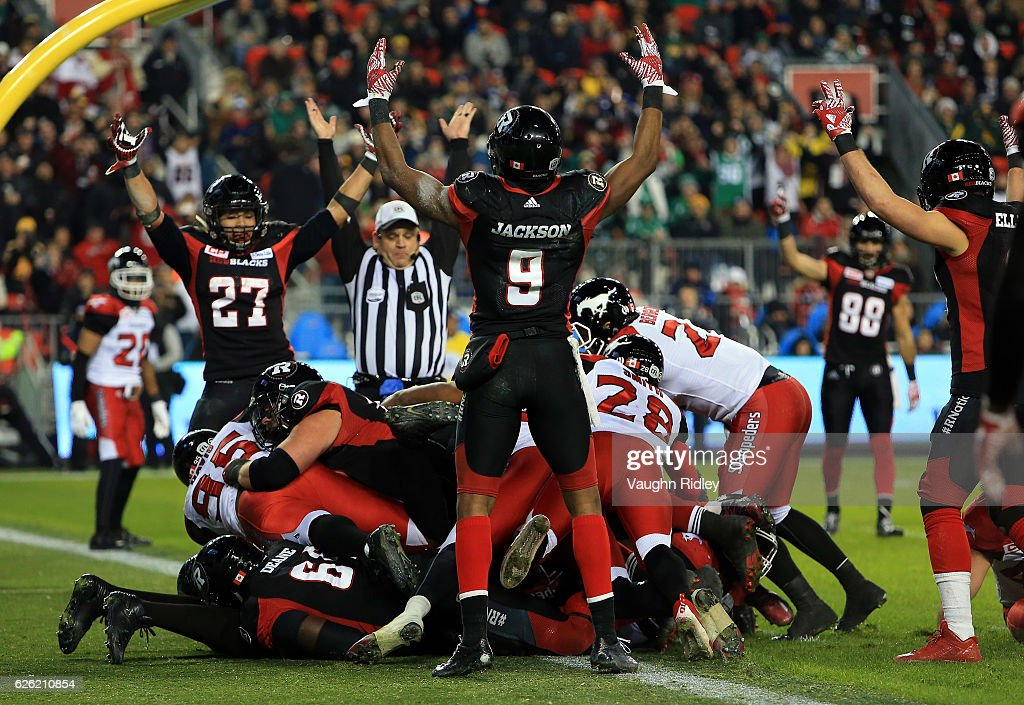 Quarterback Henry Burris #1 of the Ottawa Redblacks scores a touchdown during the second half of the 104th Grey Cup Championship Game against the Calgary Stampeders at BMO Field on November 27, 2016 in Toronto, Canada.