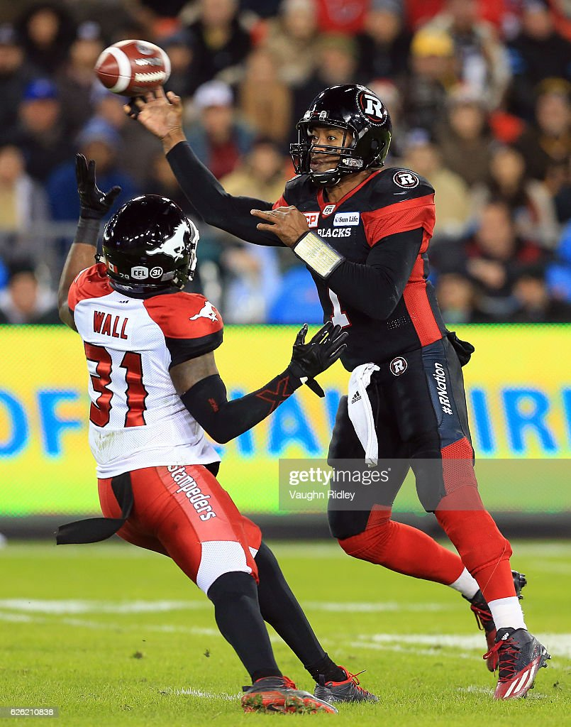 Quarterback Henry Burris #1 of the Ottawa Redblacks throws a pass while under pressure from Jamar Wall #31 of the Calgary Stampeders during the second half of the 104th Grey Cup Championship Game at BMO Field on November 27, 2016 in Toronto, Canada.