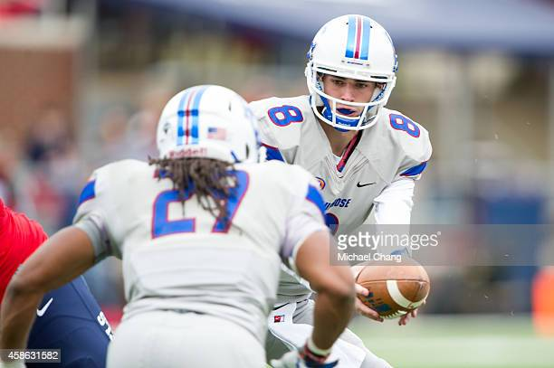 Quarterback Heys McMath of the Presbyterian Blue Hose looks to hand the ball off to defensive back Kevin Green of the Presbyterian Blue Hose during...