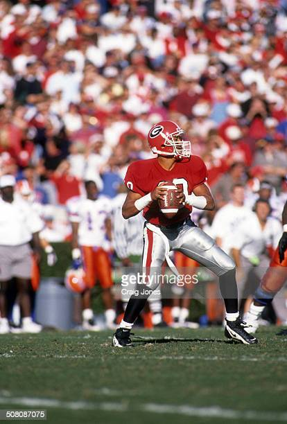 Quarterback Hines Ward of the Georgia Bulldogs readies to throw the ball during the game against the Florida Gators on October 28 1995 at Sanford...