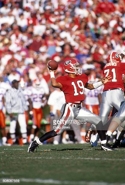 Quarterback Hines Ward of the Georgia Bulldogs throws the ball during the game against the Florida Gators on October 28 1995 at Sanford Stadium in...