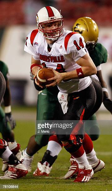 Quarterback Hunter Cantwell of the Louisville Cardinals looks to hand the ball off against the South Florida Bulls during the game on November 17...