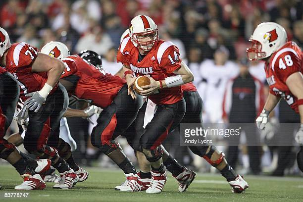 Quarterback Hunter Cantwell of the Louisville Cardinals looks to hand off theball during the Big East Conference game against the Cincinnati Bearcats...