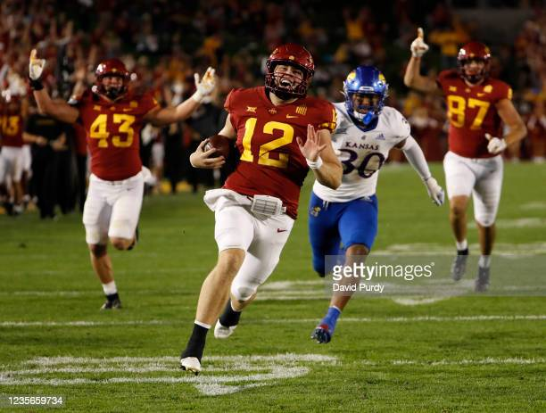 Quarterback Hunter Dekkers of the Iowa State Cyclones drives the ball to the end zone for a touchdown as linebacker Rich Miller of the Kansas...