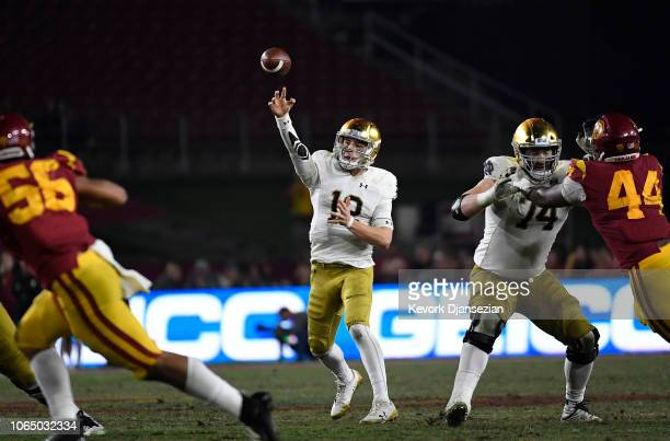 Quarterback Ian Book of the Notre Dame Fighting Irish throws a pass against the USC Trojans during the second half at Los Angeles Memorial Coliseum...