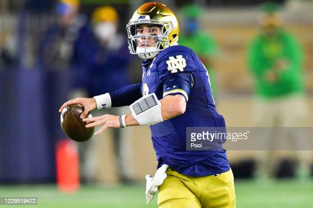Quarterback Ian Book of the Notre Dame Fighting Irish throws in the first quarter against the Clemson Tigers at Notre Dame Stadium on November 7,...