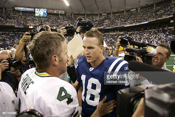 Quarterback icons Brett Favre and Peyton Manning meet after a much hyped and highly anticipated offensive showdown at the RCA Dome