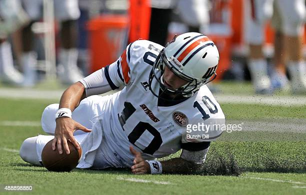 Quarterback Jabari Dunham of the Tennessee Martin Skyhawks tries to recover a bad snap during the second half of a NCAA college football game against...