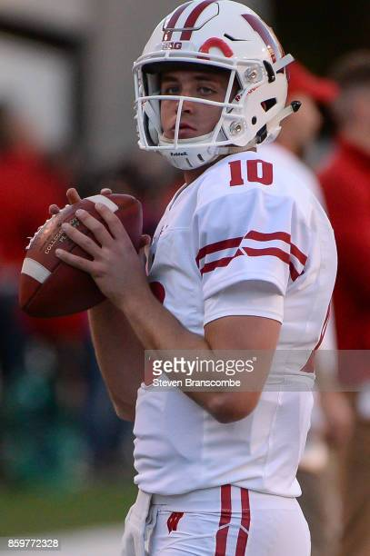 Quarterback Jack Coan of the Wisconsin Badgers warms up before the game against the Nebraska Cornhuskers at Memorial Stadium on October 7 2017 in...