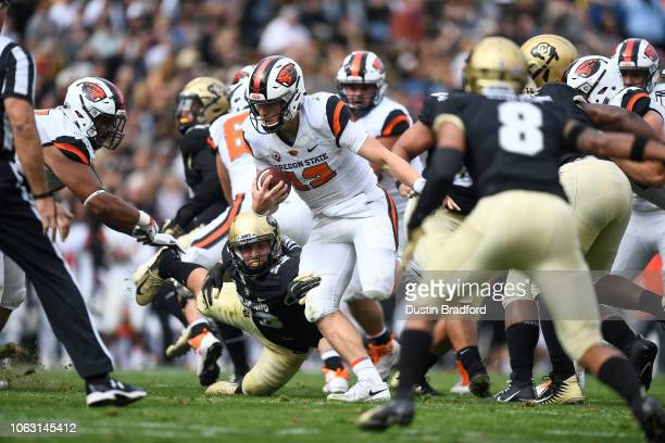 Quarterback Jack Colletto of the Oregon State Beavers carries the ball against the Colorado Buffaloes in the second quarter of a game at Folsom Field...