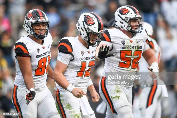 Quarterback Jack Colletto of the Oregon State Beavers is congratulated by teammates after an overtime touchdown against the Colorado Buffaloes at...