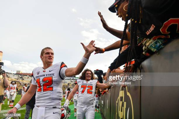 Quarterback Jack Colletto of the Oregon State Beavers is congratulated by fans after a 4134 win over the Colorado Buffaloes at Folsom Field on...