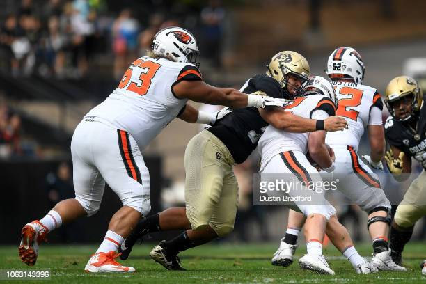 Quarterback Jack Colletto of the Oregon State Beavers is sacked by defensive lineman Mustafa Johnson of the Colorado Buffaloes in the first quarter...
