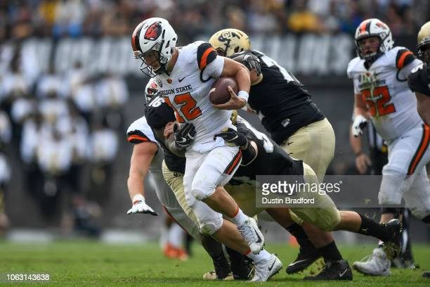 Quarterback Jack Colletto of the Oregon State Beavers is sacked by linebacker Nate Landman of the Colorado Buffaloes during a game at Folsom Field on...