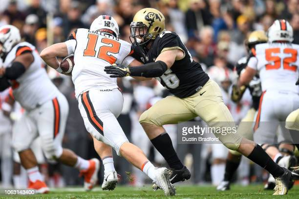 Quarterback Jack Colletto of the Oregon State Beavers is sacked in the first quarter of a game by linebacker Carson Wells of the Colorado Buffaloes...