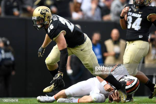 Quarterback Jack Colletto of the Oregon State Beavers lies on the field after being sacked in the first quarter of a game by linebacker Carson Wells...