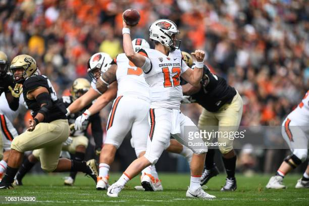 Quarterback Jack Colletto of the Oregon State Beavers passes against the Colorado Buffaloes int he first quarter of a game at Folsom Field on October...