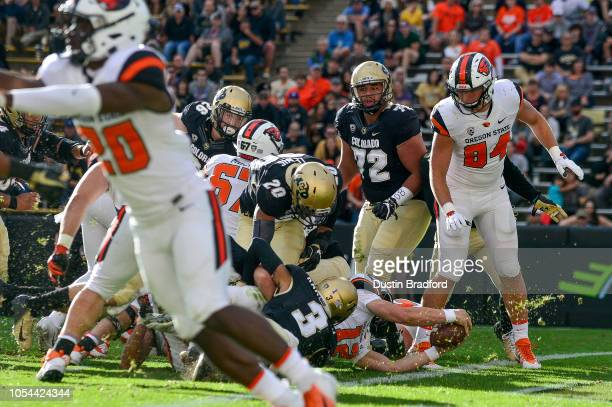 Quarterback Jack Colletto of the Oregon State Beavers reaches into the end zone for a fourth quarter touchdown against the Colorado Buffaloes at...