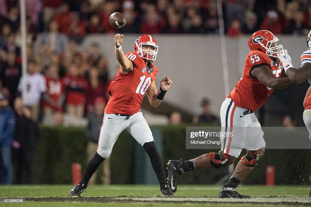 Quarterback Jacob Eason #10 of the Georgia Bulldogs throws a pass during their game against the Auburn Tigers at Sanford Stadium on November 12, 2016 in Athens, Georgia. The Georgia Bulldogs defeated the Auburn Tigers 13-7.