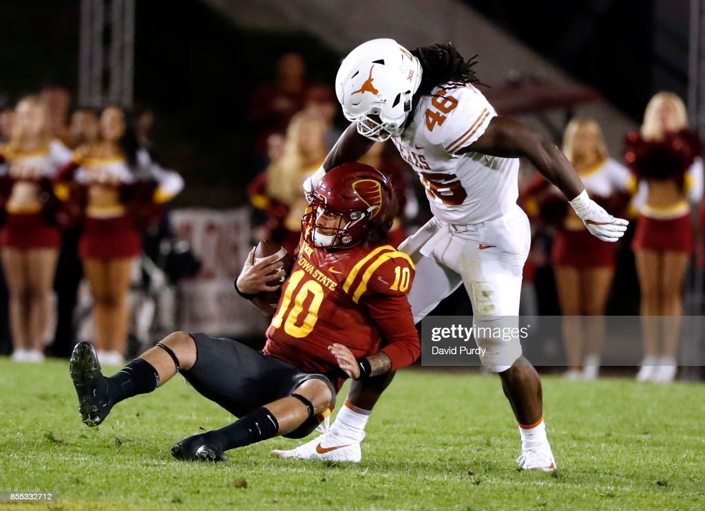 Quarterback Jacob Park #10 of the Iowa State Cyclones is sacked by linebacker Malik Jefferson #46 of the Texas Longhorns in the second half of play at Jack Trice Stadium on September 28, 2017 in Ames, Iowa. The Texas Longhorns won 17-7 over the Iowa State Cyclones.